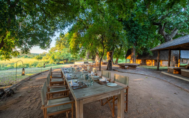 outdoor dining experience at bumbusi wilderness camp in hwange national park